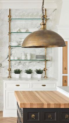 Gold pipe shelving classic neutral kitchen; use similar piping for ladder rail