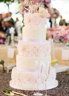 Featured Photographer: Katie Stoops Photography; Classic white and blush wedding cake with unique texture and gold decor