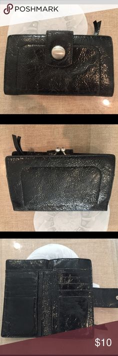 Donna Karen NY black patent leather wallet DKNY patent leather wallet. Has snap change purse with inner zip attached. Plenty of credit card slots. 6 1/2 X 4 inches. Great size. Has a little wear at corners as last picture shows, but still in great condition & has much more use left. It's hard to find a good wallet that has a snap or zipper for coins change. This one has it! Dkny Bags Wallets
