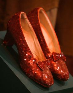 One of four known surviving pairs made for the 1939 movie, these are believed to have been worn by Judy Garland's Dorothy when she clicks her heels to return home to Kansas near the end of the film. This particular pair of ruby slippers used in the film has some one-of-a-kind touches. The inside lining reads #7 Judy Garland and the leather soles are painted red on the bottom. They are described as in mint condition but with light scuffs on the soles.