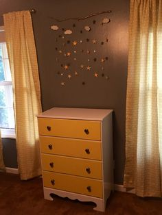 The Adoption Quest Continues!  Homemade wall hanging (could be used as mobile) and refinished dresser.  Gray and yellow nursery