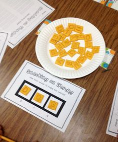 Word Recognition One- (Cheezit CVC Words) This is a way to mix snack time with learning. The Cheezit scrabble crackers can be used to create different combinations of words. Students use the crackers to make words that they see frequently. After recording the word, they can eat the crackers and form new words.