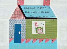"""Girl and Rooster block, based on one in Kumiko Fujita's out-of-print book, Patchwork Patterns 318. Block is altered a bit to accommodate the size of the motif of the fabric in the window. Finished size of the house is 8 1/2"""" wide X 8 3/4"""" tall."""