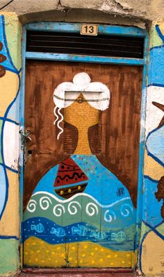Colorful whimsical door in Tylisos, Crete, Greece
