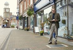 The town of Chesham in the UK has become the first town in the country to get a smart pavement that beams high-speed Wi-Fi from beneath the feet of shoppers. Pictured: Cllr Fred Wilson, Chiltern District Council.