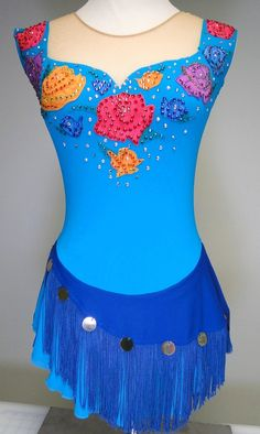 """Inspired by Sasha Cohen's """"Dark Eyes"""" figure skating dress, this Sk8 Gr8 Designs dress has hand painted rose appliques on the bodice, covered in Swarovski rhinestones, gold """"coins"""" on the sapphire blue skirt wrap, edged with fringe. www.sk8gr8designs.com"""