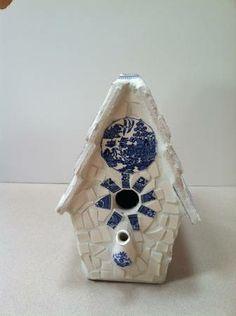 Broken China teapot birdhouse. Note teapot spout for perch. (Merrill, USA)