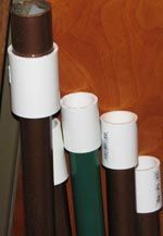 You can make the pipe fit better inside your glass totem holder by purchasing white PVC adapters and fittings (or copper ones if you are using copper) from the plumbing section of the home improvement store like the ones you see in the photo to the right. You can also wrap the ends in duct tape if you just need a little bit of tightening. I use this technique quite often.