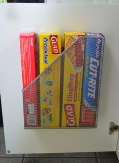 found this idea on a blog. pretty clever use for inside kitchen cabinet door, just screw onto door.