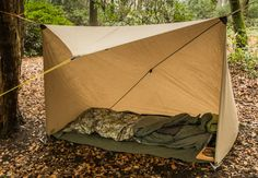 Using a 3x3m tarp this provides a cosy little shelter just about the right size for bedding and gear but still leaves a side open to enjoy the evening air or even a small cooking fire.