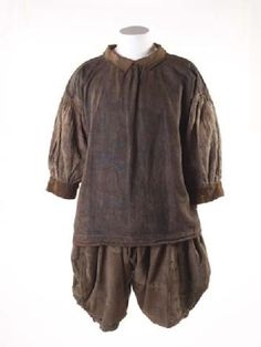 Extremely rare survival of a shirt and breeches, called slops, as worn by sailors from the late 16th through to the 18th centuries. This unique set of loose, practical sailor's clothing reveals life aboard ship. They are made of very strong linen to endure the hard, rough work. There is tar across the front from hauling ropes. The breeches are heavily mended and patched, which the sailor would have done himself.