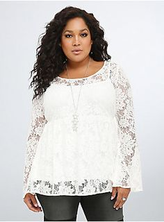 "<p>Embrace the lace (all day, everyday). Ethereal ivory lace covers this 70's-inspired bell sleeve blouse. While the lace is totes see-through, the design comes with a silky soft cami underlay. With a babydoll cut that's totally twirl-worthy.</p>  <p> </p>  <p><b>Model is 5'10"", size 1</b></p>  <ul> 	<li>Size 1 measures 31 1/4"" from shoulder</li> 	<li>Nylon/cotton/rayon; lining: polyester</li> 	<li>Hand wash cold, dry flat</li> 	<li>Imported plus size blouse</li> </ul>"
