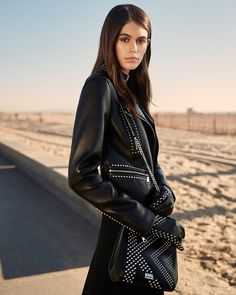 American model Kaia Gerber, this week unveiled her own clothing line in collaboration with Chanel creative director Karl Lagerfeld, in her latest move to conquer the fashion industry. Kaia Jordan Gerber, Kaia Gerber, Kaia And Presley Gerber, Studded Leather Jacket, Black Leather Gloves, Fashion Photo, Fashion Beauty, Girl Fashion, Fashion Black