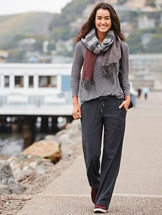 Athleta pants with gray sweater loosely tucked and a scarf