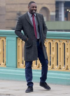 He's back: Idris Elba was back in his native London on Thursday, where he was spotted film...