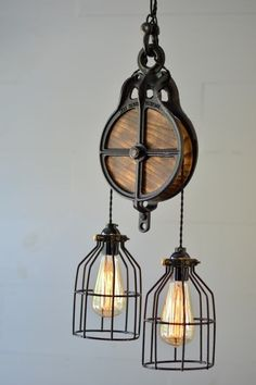Black barn pulley light, hand-crafted with vintage twisted cloth wiring,metal cages and Edison bulbs. Customize any light to suit your needs