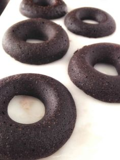 Baked chocolate protein doughnuts! Made healthy, these soft, cake like doughnuts are the perfect special healthy breakfast. And so easy! Vegan, refined sugar free, and easily made gluten free.
