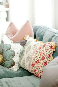 blue velvet sofa with print pillows