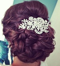 Soft bridal updo with crystal hairpiece