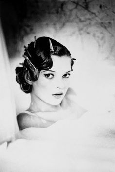 Kate by Ellen Von Unwerth this has a focus in the play of darkness draped by light. Really cool.