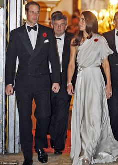 On Nov 10, 2011, at the reception and dinner at St. James's Palace for the National Memorial Arboretum appeal, Kate wore this stunning silvery grey asymmetric gown, made exclusively for her by designer Jenny Packham.