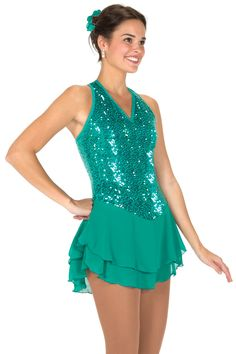 Jerry's figure Skating Dress #102 - Sequinessa Dress - Jade. Sequinessa Dress - A sleek, sophisticated dress with sparkling tone on tone tiny sequins, a V-neck at the front and a halter style back with clear adjustable straps to keep everything in place. The double georgette skirt is kept fairly flat and matches the body to create a long, slim look. Lined.
