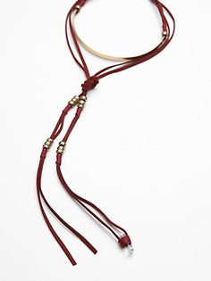Stellar Soul Leather Bolo | Statement suede bolo style necklace featuring metal beads and fringe accents. Adjustable lobster clasp closure.