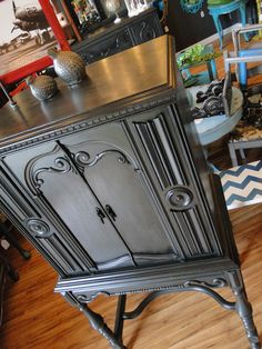 Black Smoke, wine cabinet out of an old radio. Dark Gray exterior and Deep red interior. Modern Vintage