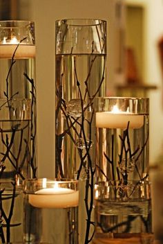 Simple, elegant centerpieces!  Twigs, water, floating candle - done!