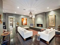 Dining-living living room using black colours with hardwood & fireplace - Living Area photo 129450
