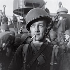 An American Marine readies to land on Guadalcanal during the five-month struggle for the island between late 1942 and early 1943. Three thousand miles south of Tokyo, Guadalcanal was a major shipping point for military supplies. The Allied victory there in February, 1943, marked a major turning point in the war after a string of Japanese victories in the Pacific. (Joe Scherschel—Time & Life Pictures/Getty Images)