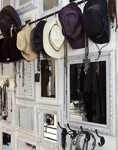 I like this way of storing accessories: all on a mish mash on one wall with a bunch of mirrors behind them.