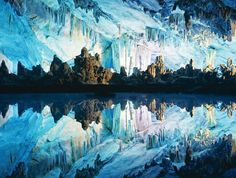 Reed Flute Caves, China. -- The breathtaking stalactites, stalagmites and pillars were created through water erosion beautifully decorating this 240-meter-long cave.