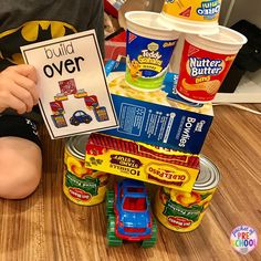 STEM Challenge...build over! Building with food containers is a fun way to incorporate environmental print into the blocks center. Fun for a grocery store or nutrition theme. Preschool, pre-k, and kindergarten.