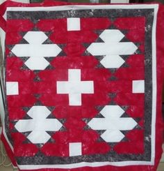The Navajo style quilt pattern is based loosely on a design often used in rugs. The design is very simple but striking, using qst's and squares only