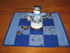 Winter table Topper with dark blue squares by Piecebypiecequilting