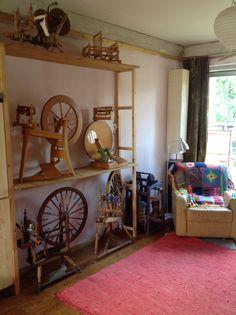 Herd of spinning wheels nicely stored on shelves