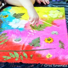 """""""sunprints"""" from watered down acrylics on wet fabric. The leaves keep some areas damp, so the pigments migrate away."""