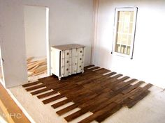 """wood"" dollhouse flooring made of popsicle sticks! I think there might be a doll house make over coming soon..."