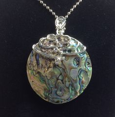 A personal favorite from my Etsy shop https://www.etsy.com/listing/267686142/abalone-shell-magnifying-glass-necklace