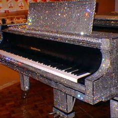 No doubt it sounds as good as it looks.. Swarovski Crystal Piano