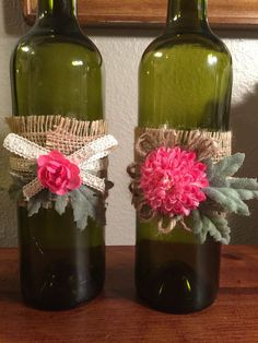 This wine bottle centerpiece is accented with natural burlap, cream lace ribbon, pink flowers and mint green leaves. This wine bottle centerpiece is perfect for a wine themed bridal shower or wine theme wedding. Ready to ship!!! Set includes 3 green 750ml wine bottles. Custom orders are available if there is a different color scheme or quantity you are looking for. Simply message me. Like to see my other wine decor ideas and custom gifts? Click the link below to take you directly to my Etsy…