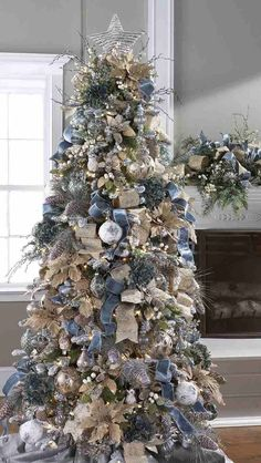 Winter Christmas tree decoration with blue, gold and silver along with burlap ornaments. decor blue gold 20 Most Adorable Collection Of Rustic Christmas Tree Decor Ideas - Blurmark Silver Christmas Tree, Beautiful Christmas Trees, Christmas Tree Themes, Noel Christmas, Rustic Christmas, Xmas Decorations, Blue Christmas Decor, Christmas Tree Ribbon, Champagne Christmas Tree