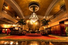 Amway // Grand Rapids // The opulent lobby of the Amway Grand Plaza Hotel defines old-world glamour, featuring three mighty 4000lb Czech chandeliers of Austrian crystal, a wooden-gilded sunburst, which previously hung for 150 years in a Venetian palace, and 7000 ft2 gilt domed ceiling, the largest gold-leaf installation in the country. The hotel's charming historical details send guests back to a bygone era of splendour.
