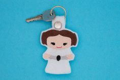 """""""May the Force be with you!"""" Love Star Wars? Do you know all the lines by heart? Well now you can be a part of the action! Keep your favorite Star Wars characters close to you! Fight against the power of the Dark Side with Leia.    This key chain is made of felt and you won't have to worry about it breaking from being bent or dropped.     Products are created in a Smoke FREE environment!    This item includes one felt key chain and 1 metal key ring. Please allow for slight variations…"""