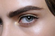 Strong brows and great simple eye markup. No shadow but a very think line of liquid liner. Love it