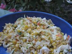Texas Coleslaw - cabbage, red onion, diced green chilies, cilantro, mexicorn, shredded cheddar and dressing made of ranch dressing, lime juice and cumin.  Yum!