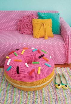 What better way to decorate your room than with a Sugar High Donut Pouf? This easy crochet pattern will transform your room into a space that's uniquely yours by providing a cushy, cozy place to sit or rest your feet.