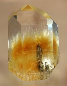 Rutilated Quartz is Quartz Stone with Rutile enclosures. Rutile is a mineral that is made up mostly of titanium dioxide, or As a mineral, rutile is very high on the refractive index and disperses more than almost any other mineral. Minerals And Gemstones, Rocks And Minerals, Beautiful Rocks, Mineral Stone, Rutilated Quartz, Rocks And Gems, Mellow Yellow, Gemstone Colors, Stones And Crystals