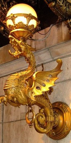 Bronze dragon light fixture at the entrance to the Drake Hotel on Walton Street in Chicago, Illinois.